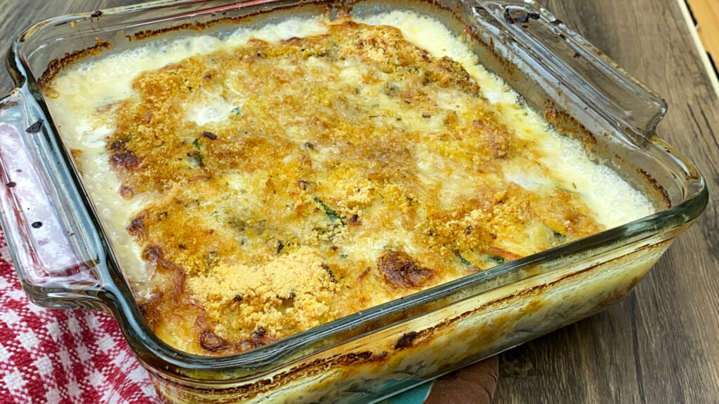 Baked zucchini casserole with cheese and breadcrumbs.