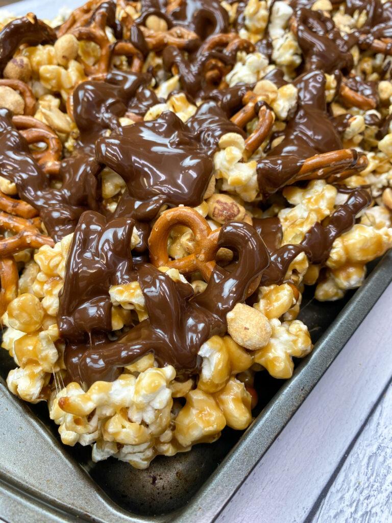Caramel popcorn munch on a cookie sheet.
