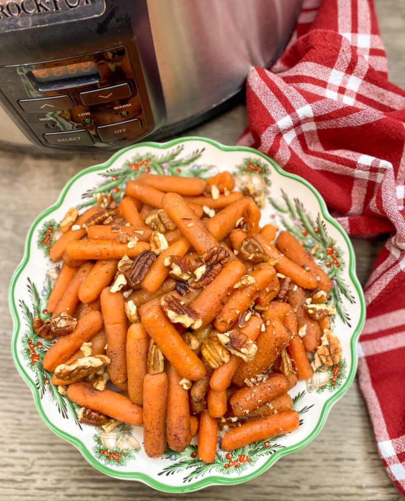 Cooked carrots in a Christmas bowl.