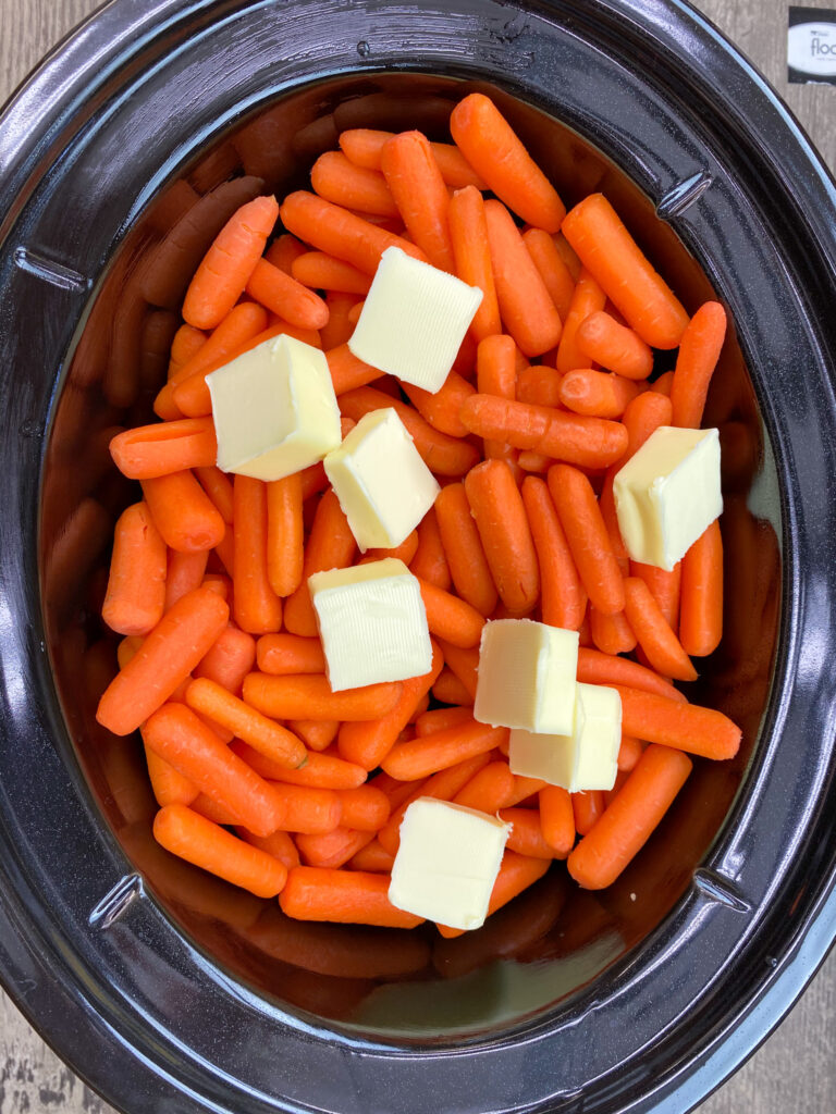 Carrots in a slow cooker with butter.