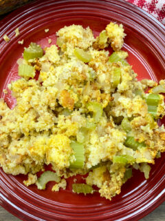 Southern cornbread dressing on a red plate.