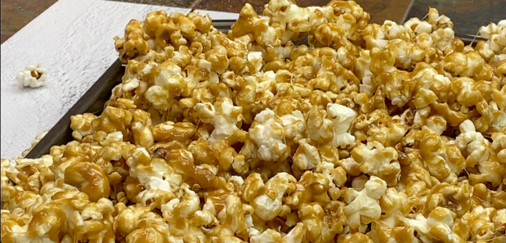 Caramel popcorn on a cookie sheet.
