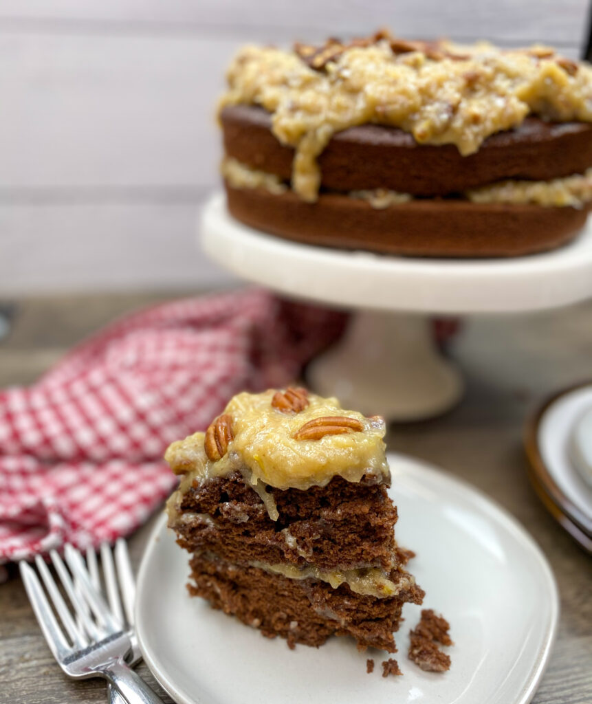A slice of German chocolate cake on a white plate.