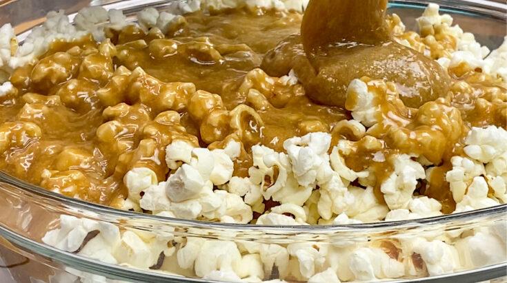 Pouring homemade caramel over popcorn.