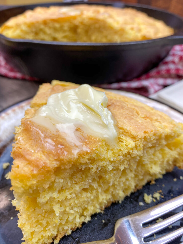 A slice of cornbread on a plate.
