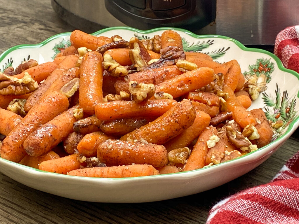 Cooked carrots in a bowl.