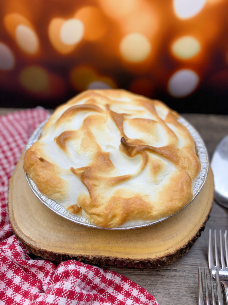 Homemade butterscotch pie on the counter.
