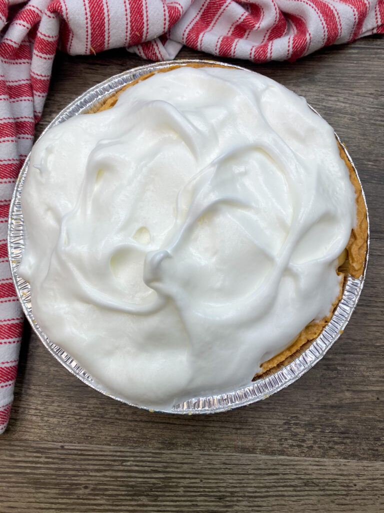 Raw meringue on top of a butterscotch pie.