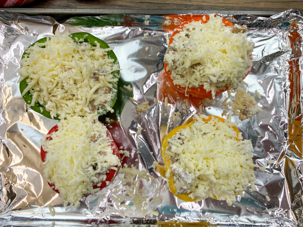 Stuffed bell peppers with mozzarella cheese on top.