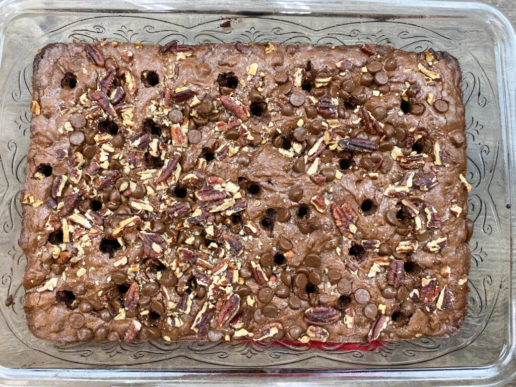 Poking holes in baked brownies.