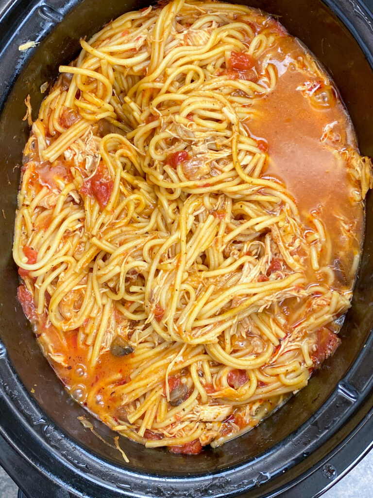Italian chicken with spaghetti in a slow cooker.