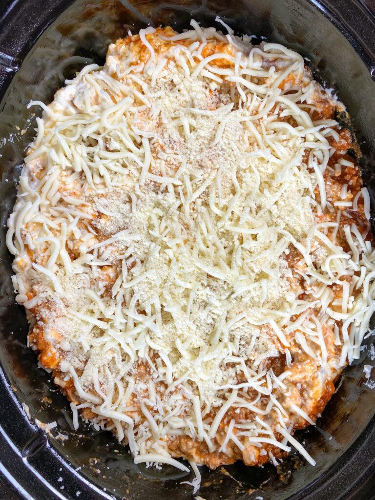 Layering lasagna ingredients.