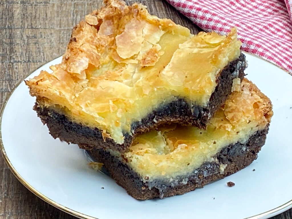 Chocolate chess squares on a white plate.