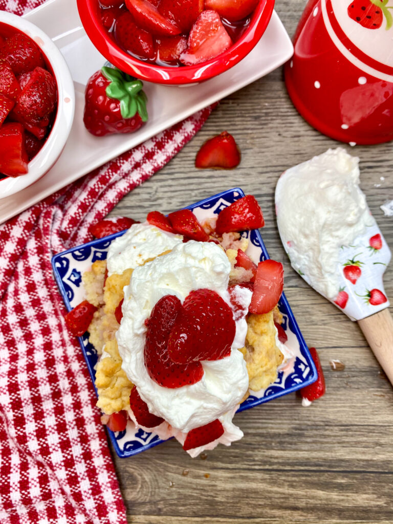 Homemade strawberry shortcake on a plate.