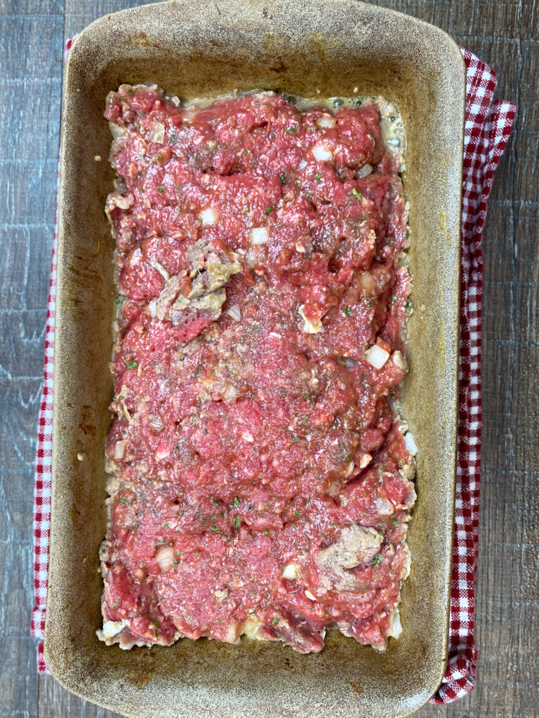 Ground beef in a loaf pan.