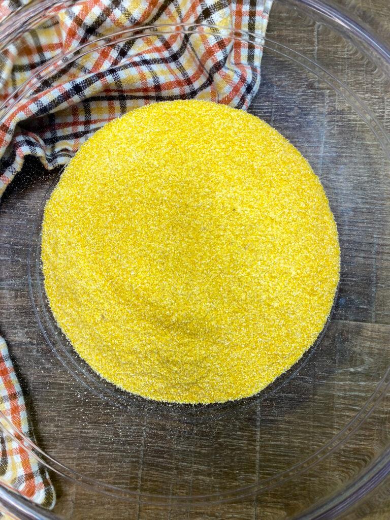Yellow cornmeal in a bowl.