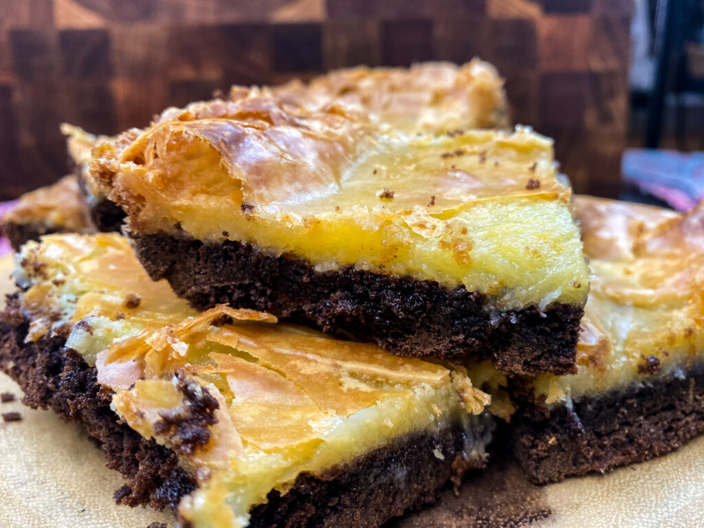Stacked chocolate gooey bars on a plate.