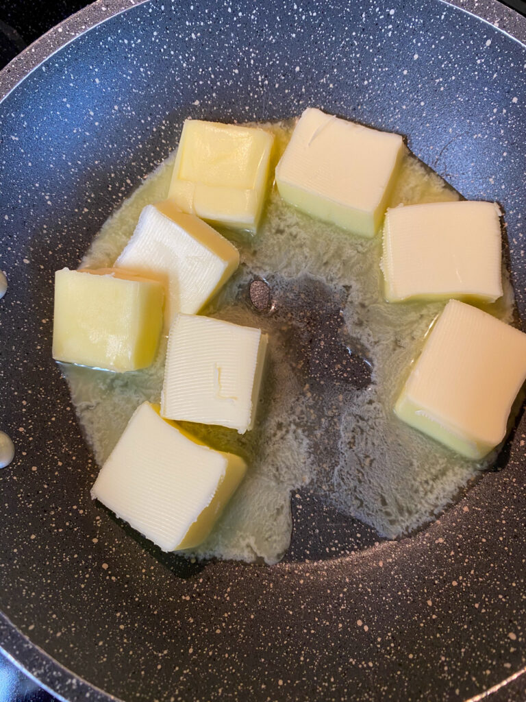 Cubed butter in a saucepan.