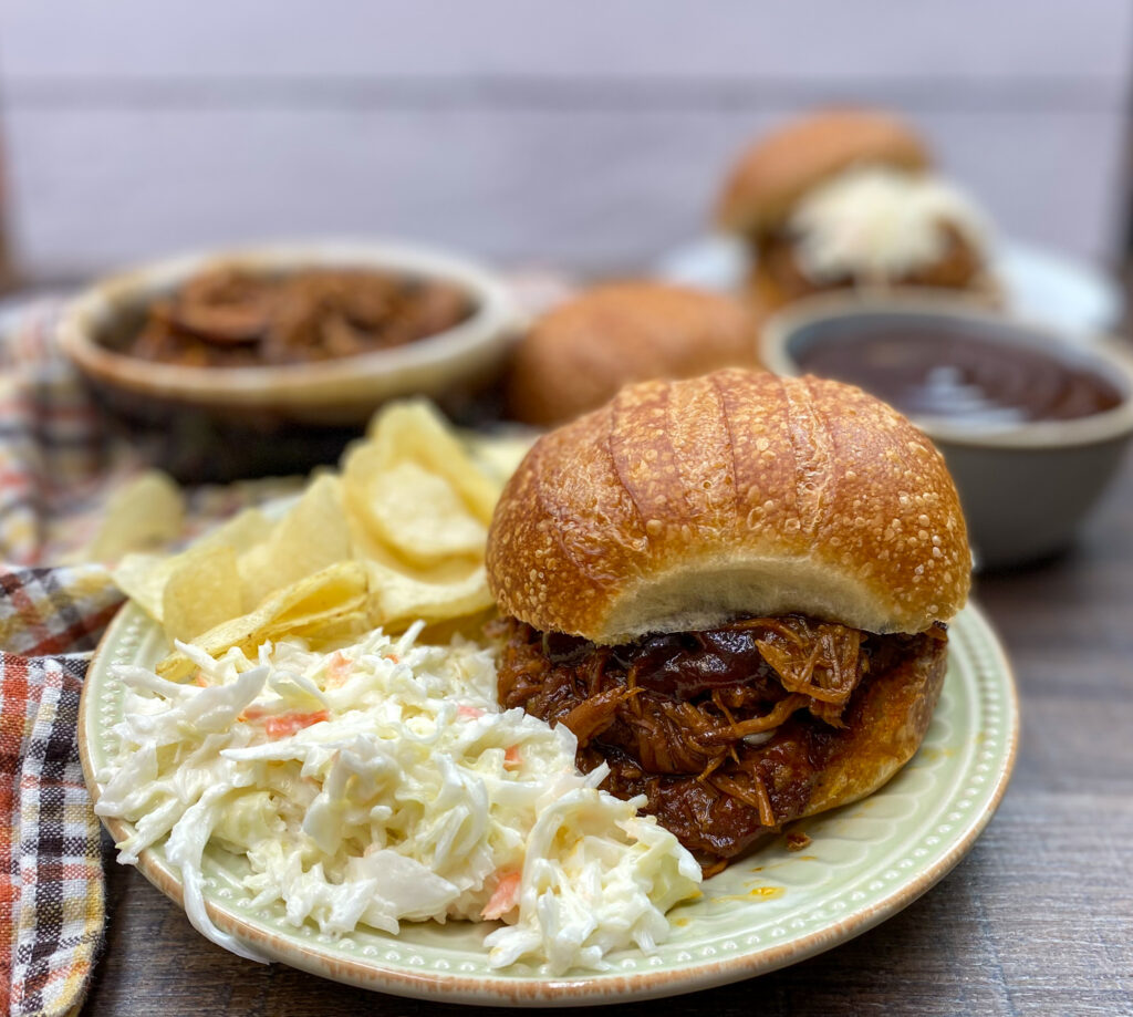 An easy pulled pork recipe on a plate.