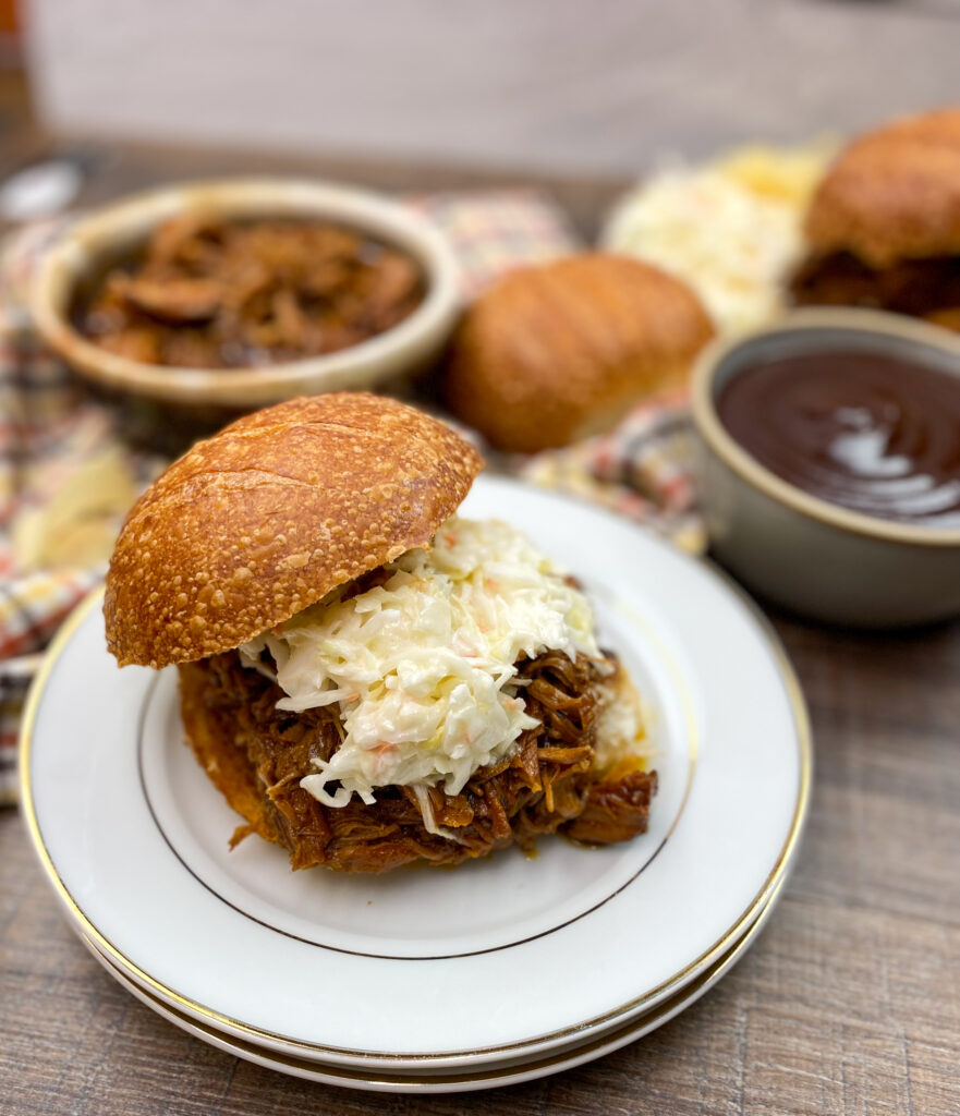 Pulled pork sandwich on a plate.