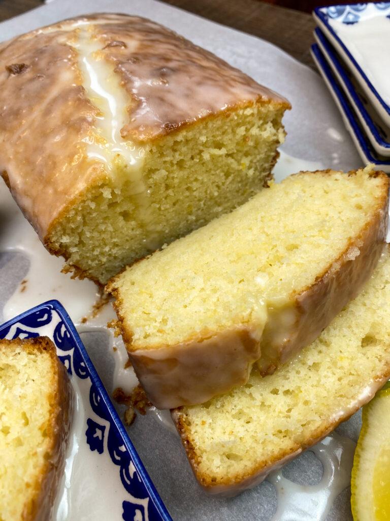 Photo of lemon bread slices on parchment paper.