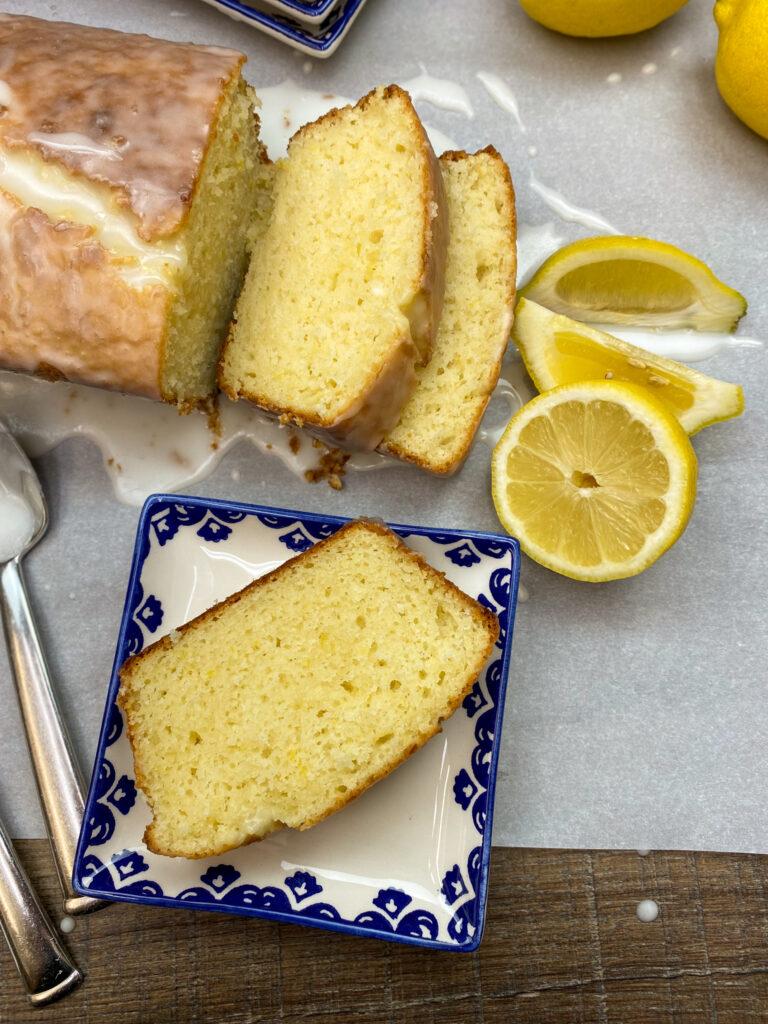 Lemon loaf sliced on a plate.