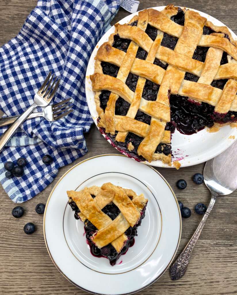 Blueberry pie on a plate.