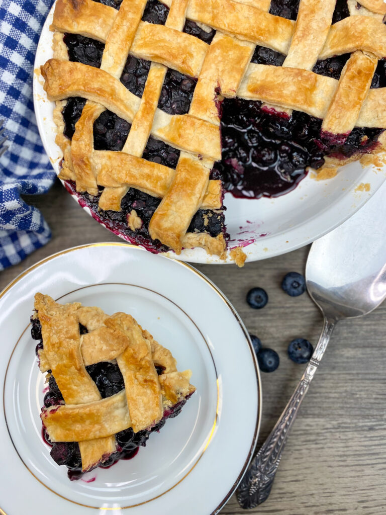 Pie crust on a plate in a blueberry pie.