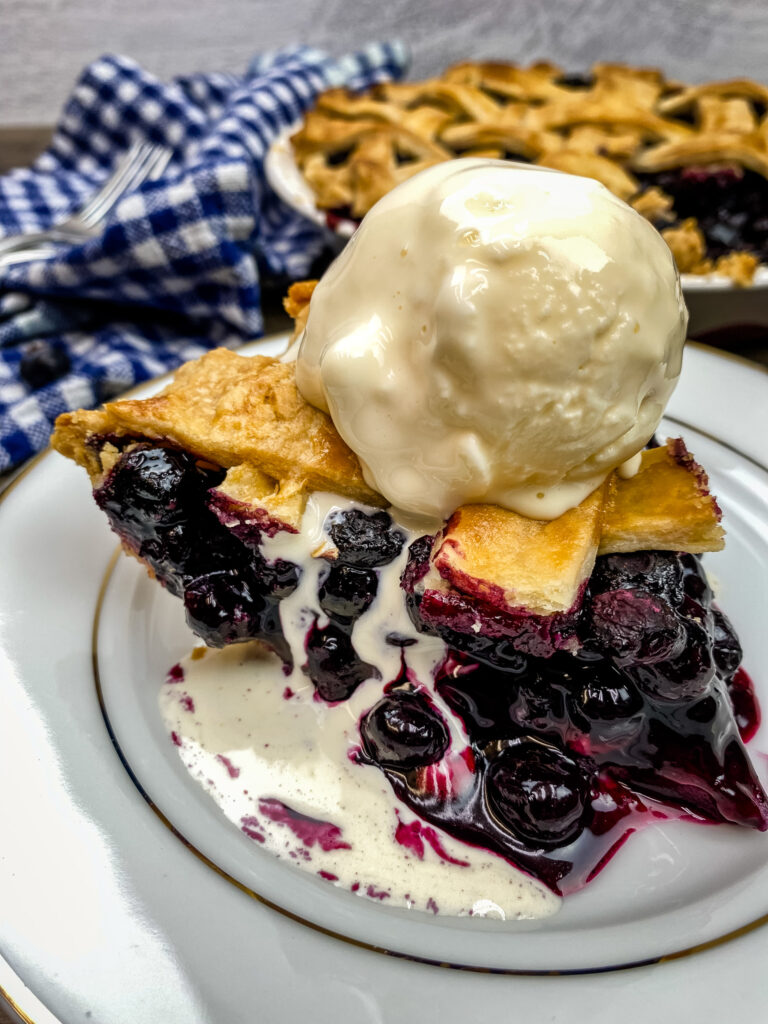 Blueberry pie with a scoop of ice cream on top