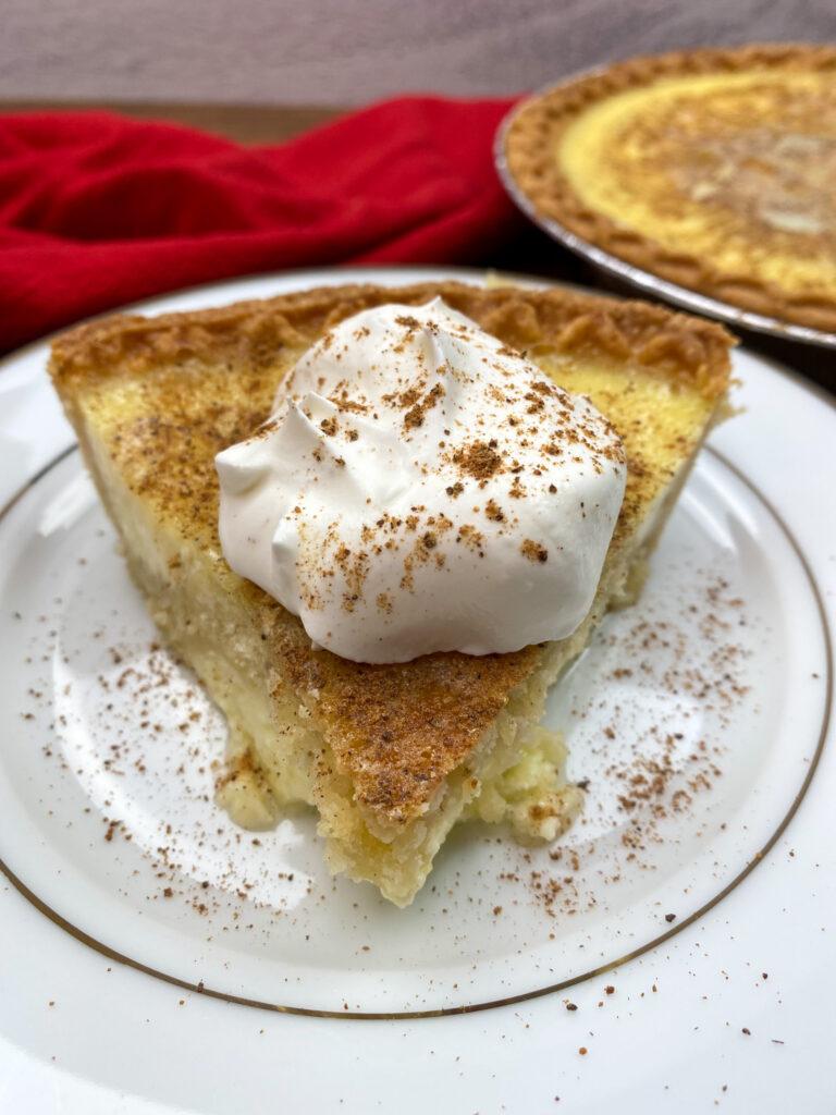 Egg custard pie on a white plate.