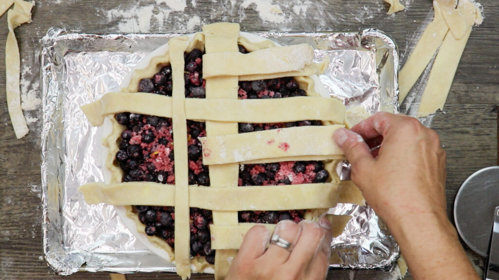 Preparing the lattice on the pie.
