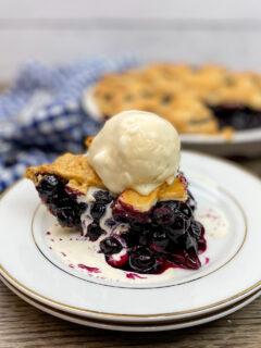 A scoop of ice cream on top of pie