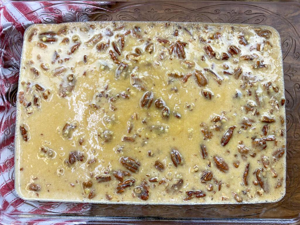 Pecan pie cake mix in a baking dish.