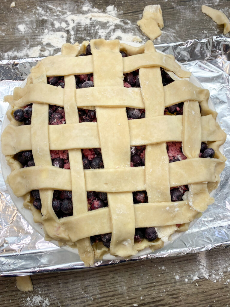 Pre-baked blueberry pie with lattice on top.