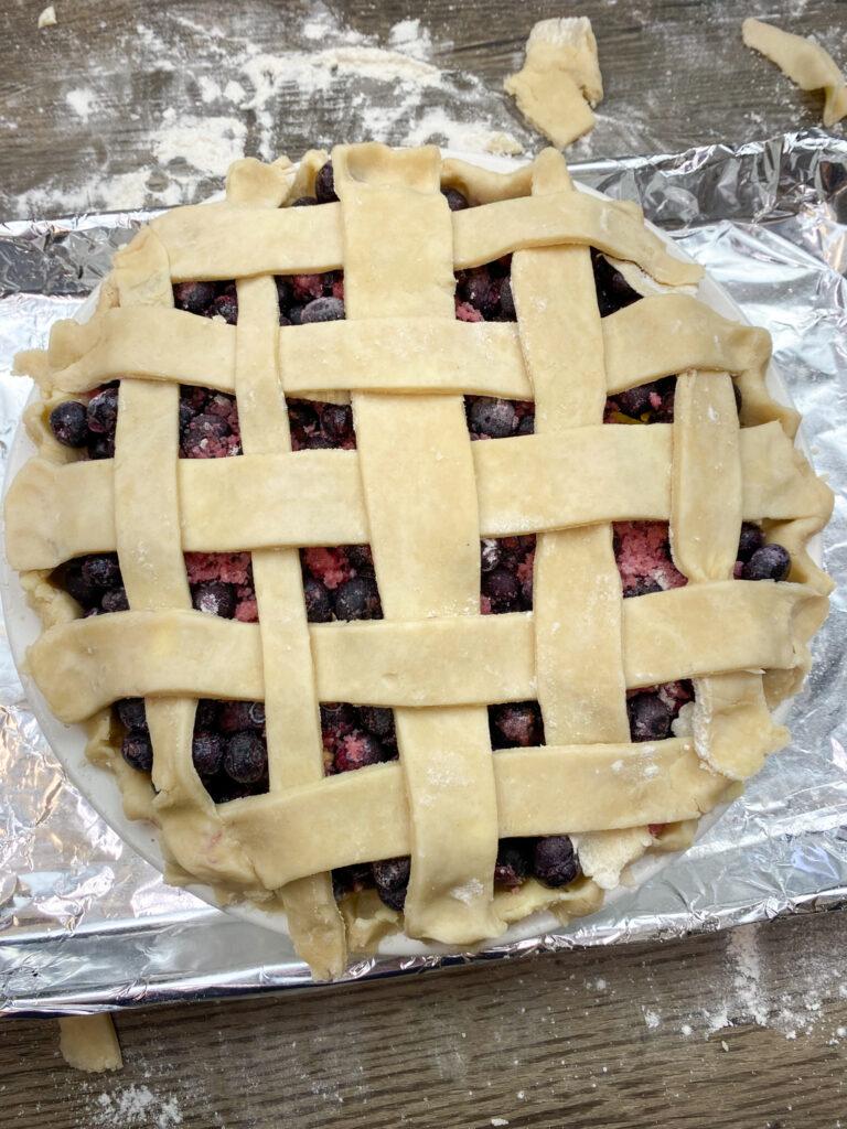 Lattice pie crust on top of a pie.