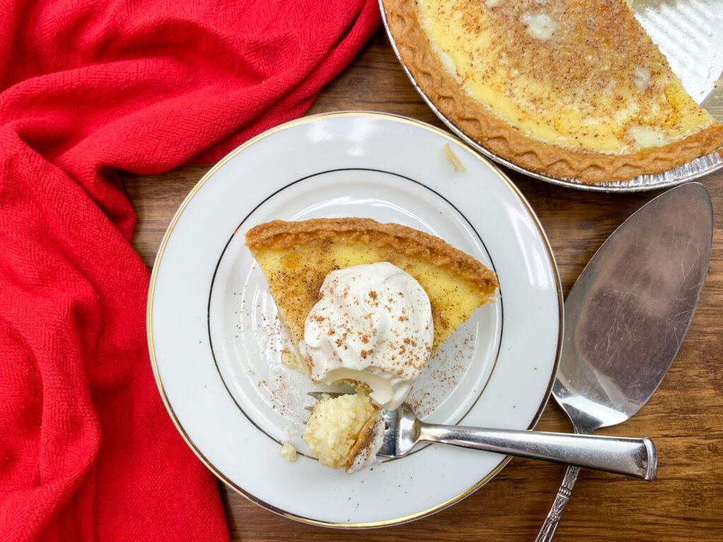 Golden brown custard pie on a white plate.