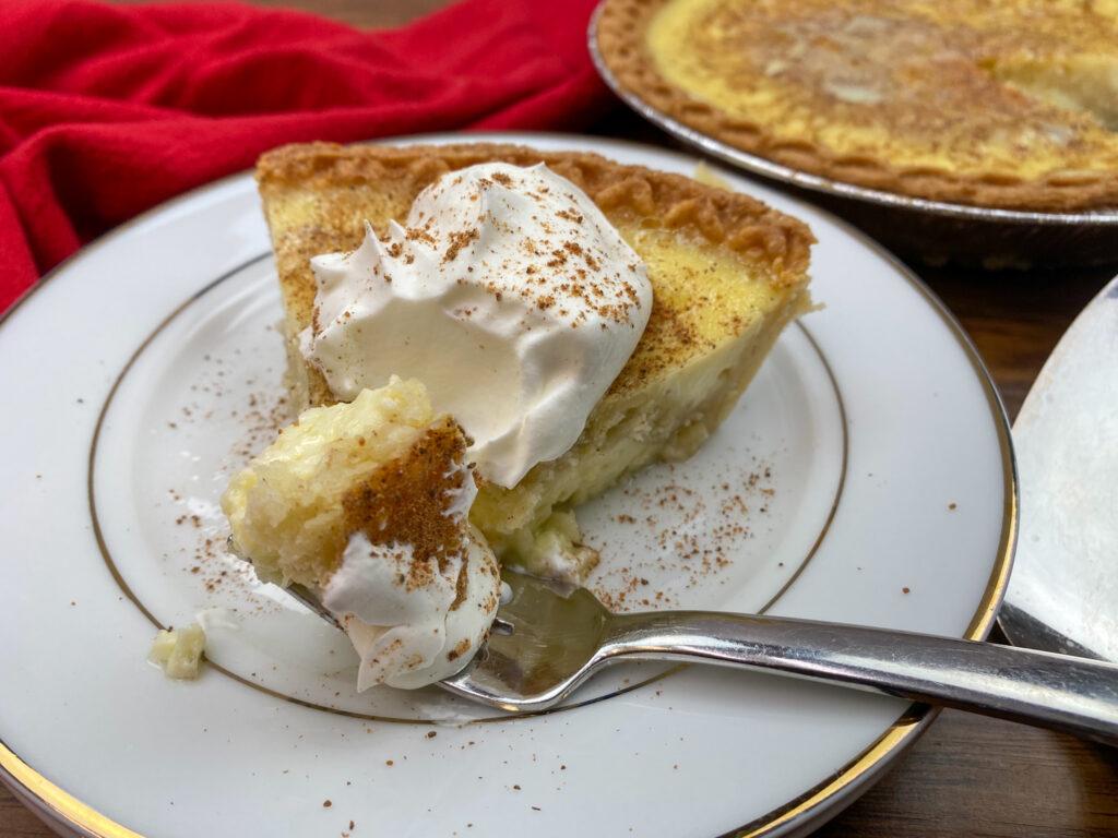 Egg custard pie on a white plate