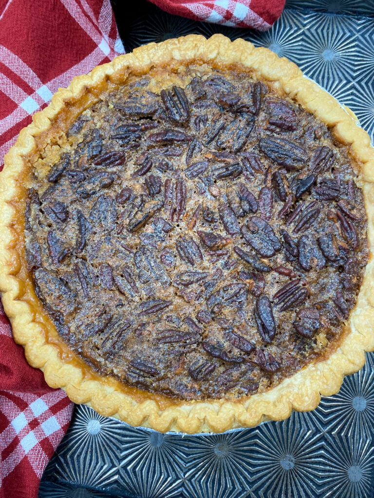 Cooked pecan pie with maple syrup.