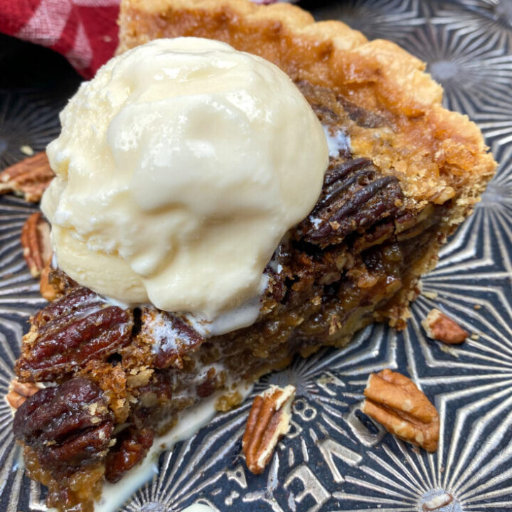 Maple pecan pie with ice cream on a cookie sheet.