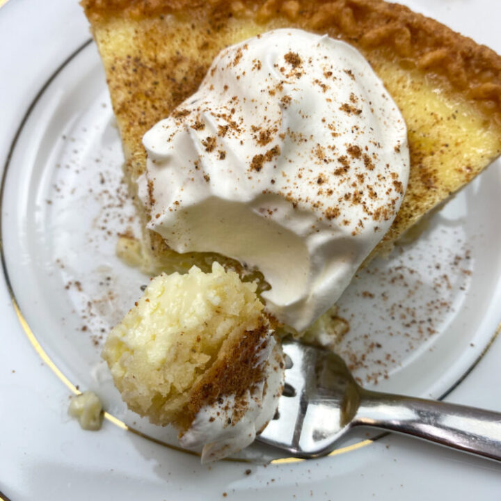 A slice of egg custard pie on a white plate.