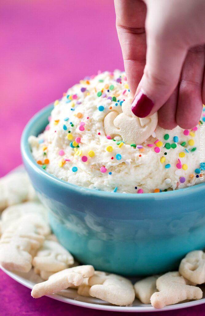 Funfetti cake batter dip in a blue bowl