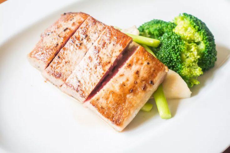 Albacore tuna on a white plate.