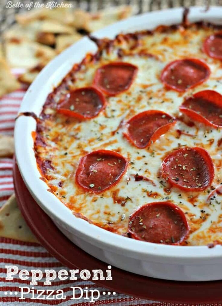 Pepperoni pizza dip in a white dish.