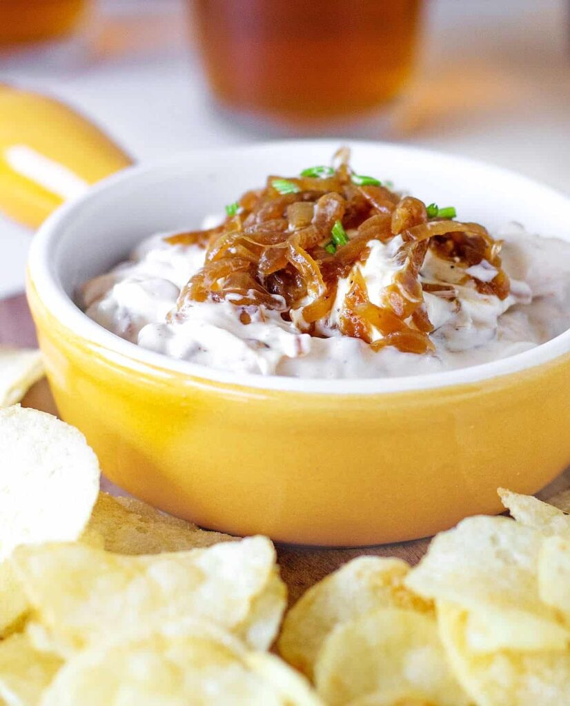 Red onion dip in a yellow bowl