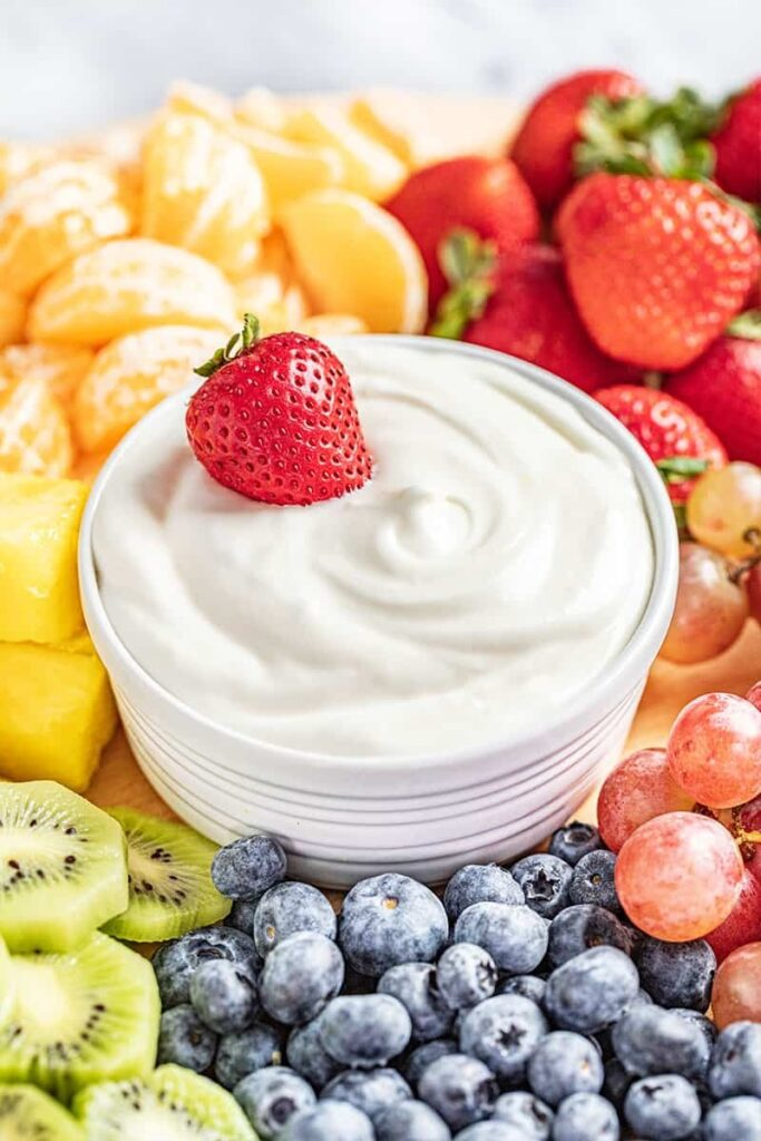 Fruit dip with a strawberry in the middle.