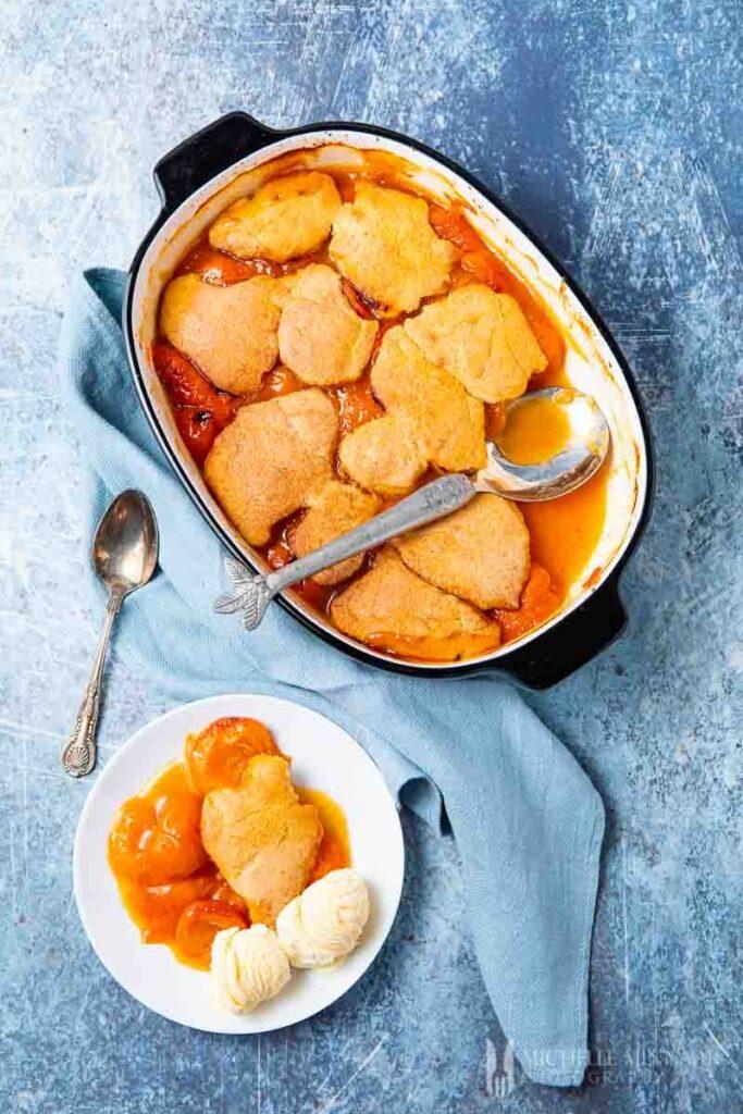 Apricot cobbler in a pan.