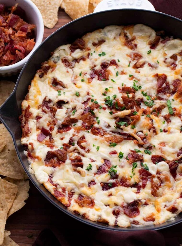 Cheesy bacon spinach dip in a cast iron skillet