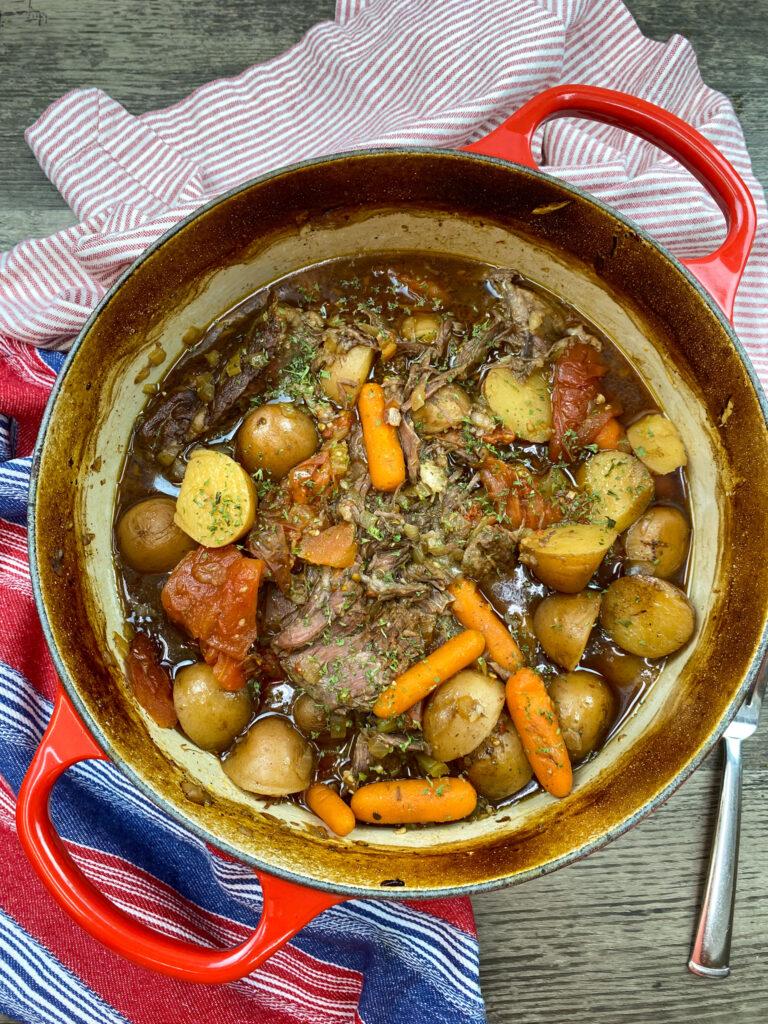 Chuck roast in a red dutch oven