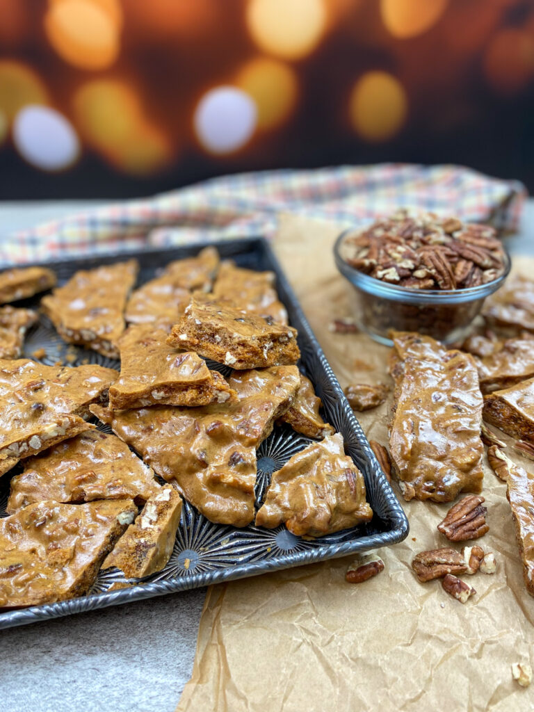 Pieces of pecan brittle on a cookie sheet