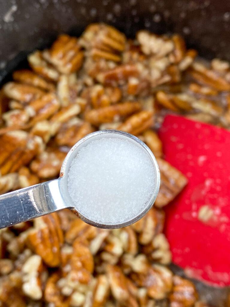 Adding salt to a saucepan